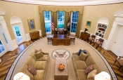 Image: The redecorated Oval Office of Obama has new carpeting, wallpaper and sofas at the White House in Washington
