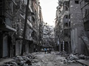 A ruined street after heavy shelling in Aleppo